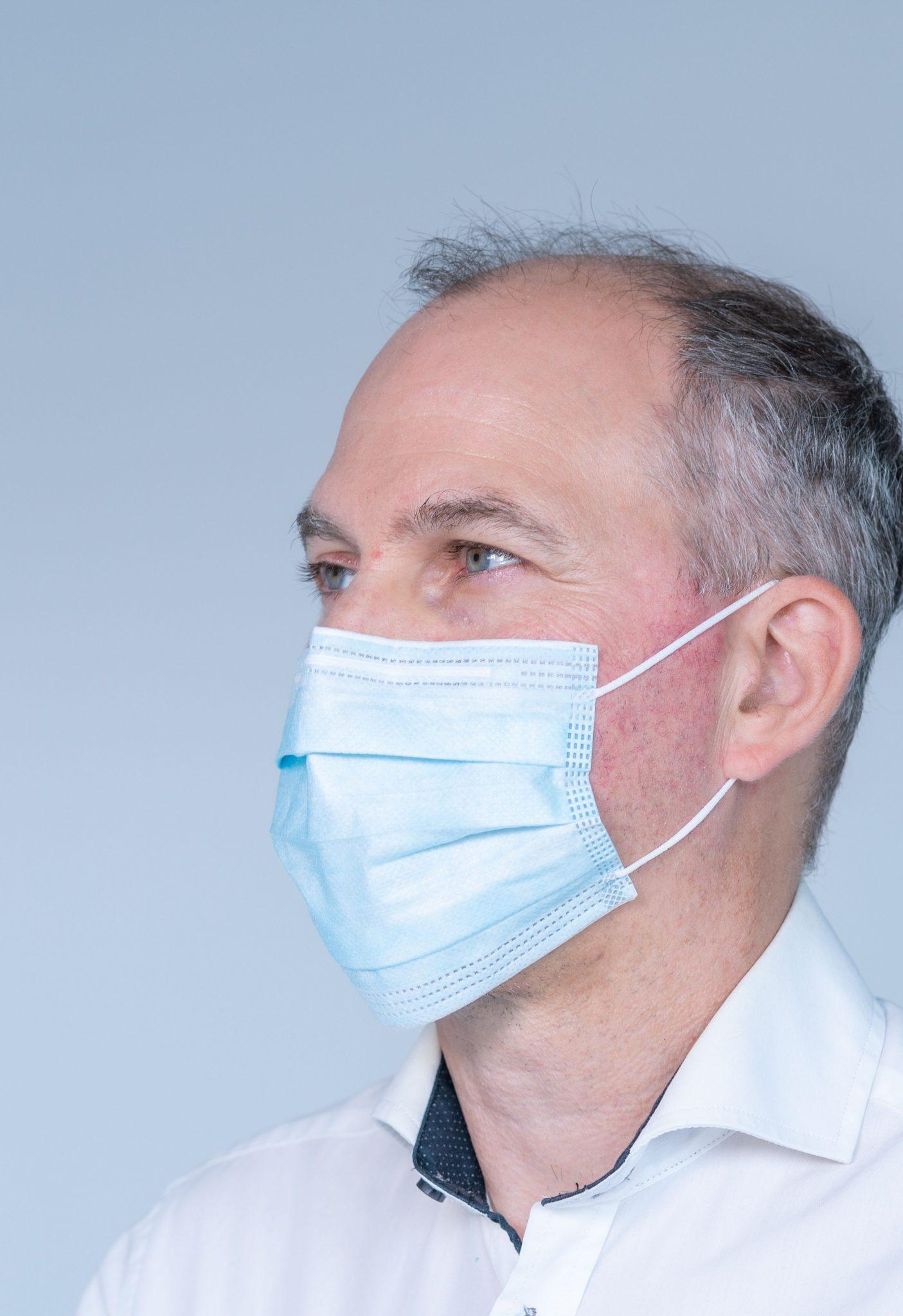 Man in a blue medical mask